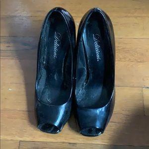 Peep toe black high heels. Few scratches on heel.